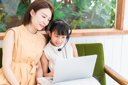 asian girl studying with a PC,correspondence course, mother and daughter