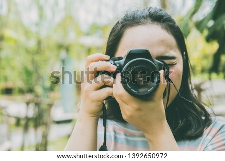 Asian Girl Teen using DSLR Camera Photography Vintage color tone