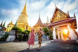 Asian girl walk in Wat phra kaew and grand palace travel in Bangkok city, Thailand