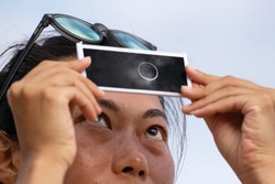 Asian girl watching the eclipse