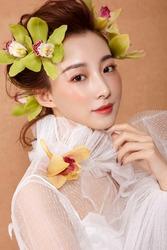 Asian girl wearing real flower for headdress