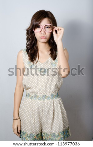 Asian girl wears a funny glasses - stock photo