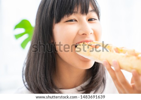 asian girl who eats a sandwich #1483691639