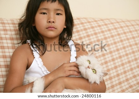 Asian girl with beautiful persian long hair white cat on her arms
