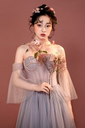 Asian girl with flowers wearing headdress with flowers