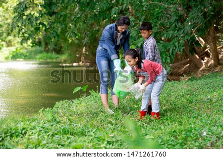 Asian girl with group of kids volunteer charity environment , Ecology cleaning green concept #1471261760