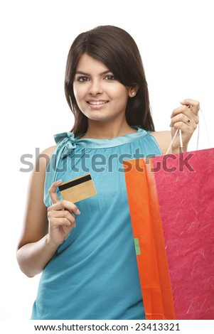 Asian girl with shopping bags and holding the credit card - stock photo