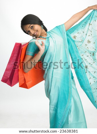 Asian girl with shopping bags in a very happy mood