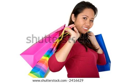 asian girl with shopping bags over a white background