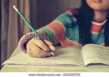 Asian Girl writes to writing-books.