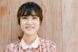 Asian Girl young teen hipster closeup head happy smile vintage on wood background
