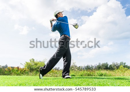 Asian golfer hit a golf ball by golf-club driver