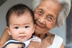Asian Grandmother with baby