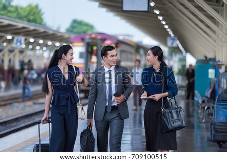 Asian group business man and business woman walking subway  train station classic background , go away concept, 25-35 Year old