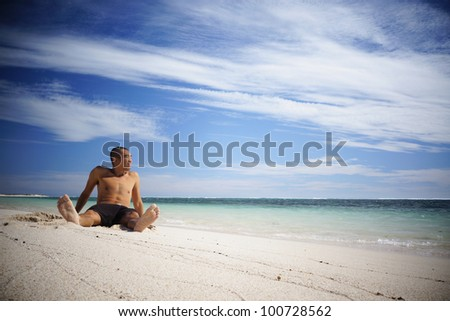 Asian guy relaxing on the beach in Western Australia.