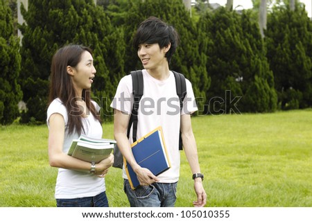 Asian happy college student at a campus