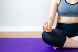 Asian healthy women focus on her breating while doing Yoga.