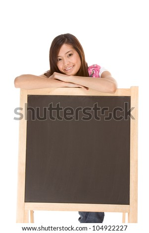 Asian High school girl student standing  by blackboard