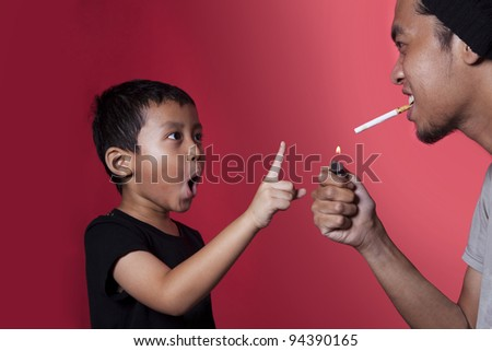 Asian kid asking a smoker to stop smoking shot over red background