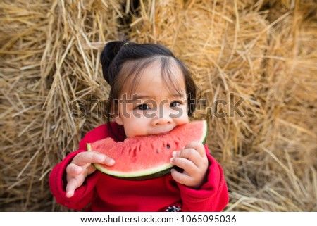 Asian kid eating watermelon happiness