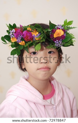 Asian kid with wreath on head