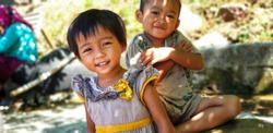 Asian kids have vocation and playing in the garden at summer
