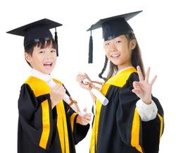 Asian kids in graduation gown
