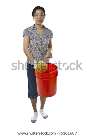 Asian lady carrying large bucket with sponge while wearing causal clothing on white background