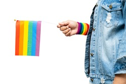 Asian lady holding rainbow color flag isolate on white background, symbol of LGBT pride month celebrate annual in June social of gay, lesbian, bisexual, transgender, human rights.