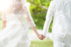 Asian lady in wedding dress run with her husband, out door pre wedding activity, marriage and wedding concept
