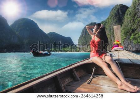 Asian lady relax on long tail boat at maya beach, Phi Phi island near Phuket in Thailand #264614258