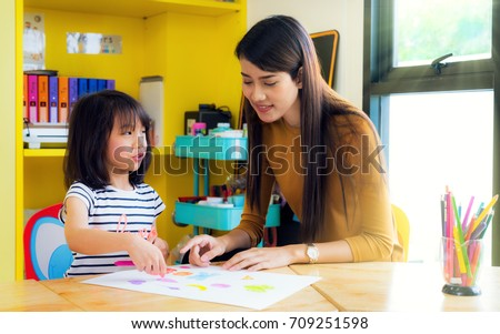 Asian lady teacher teach about drawing and art subject to her student on table in class room in preschool, education, school, teacher, kid snd student concept