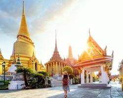 Asian lady walking and travel in Wat Phra Kaew and Grand palace, bangkok city, Thailabd, Asia