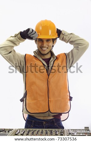 asian latino hard hat worker with his tools