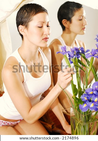 stock photo Asian lingerie model on antique vanity