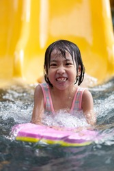 Asian Little Chinese Girl playing at water park outdoor