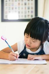 Asian little girl doing her homework
