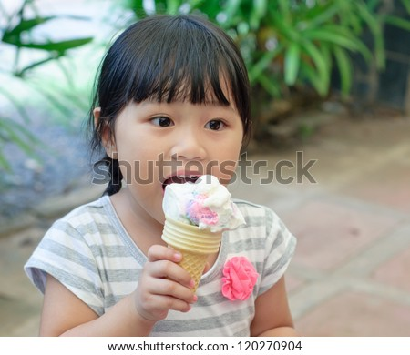 asian little girl eating ice cream, happiness moment