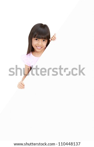 Asian little girl hiding behind a white board
