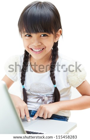 Asian little girl is sitting with her laptop computer, Isolated over white
