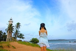 Asian little girl looking at Indian ocean in Galle, Sri Lanka.
