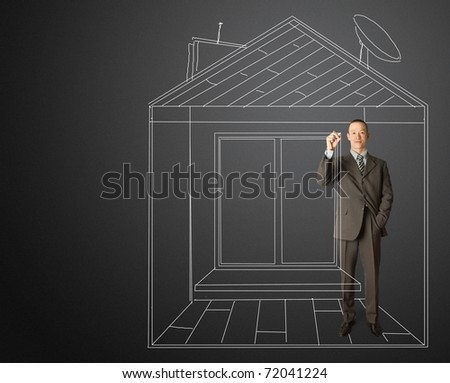 asian male businessman with marker in fictional house writting something on glass writeboard