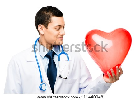 Asian male doctor holding human heart  isolated on white background