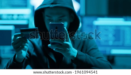 Asian male hacker fraudulently use credit card for payment Stock photo ©