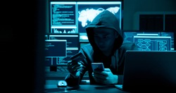 Asian male hacker fraudulently use credit card for payment with computer