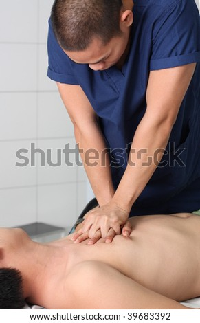 asian male nurse performing resuscitation