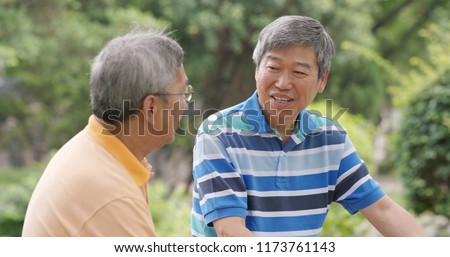 Asian Male old friends talking together at outdoor park #1173761143