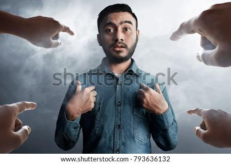 Asian man accused Stockfoto ©