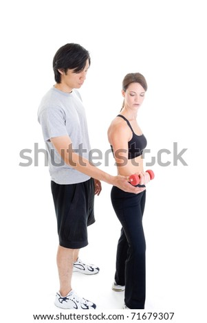 Asian man and Caucasian woman in work out clothing isolated on white. - stock photo