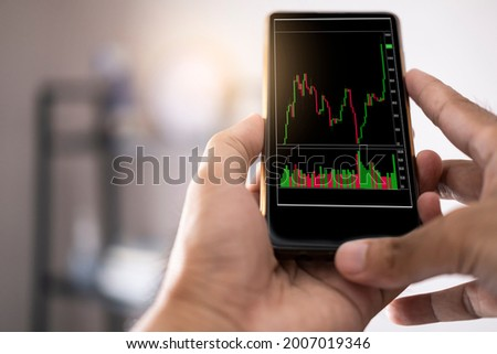 Asian man business holding tecnology graph bitcoin. For business stock market finance, lifestyle and ethereum or block chain tecnology change to dollar Stock market Foto stock ©